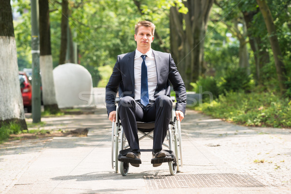 7226577_stock-photo-young-disabled-man-on-wheelchair.jpg